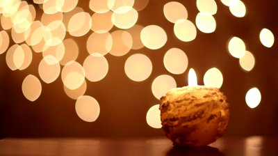 Stock Footage Round Yellow Candle Lit Rain Of Sparkles At Background